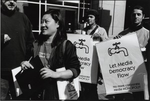 "Inja Coates at a ""Let Media Democracy Flow"" protest"