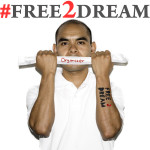 "A photo from the #Free2Dream campaign of Cristobal Valencia holding a ""Organizer"" banner"