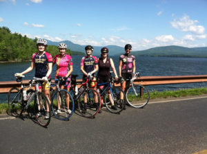 Jill Feldstein, far left, and Jeni Mattingly, far right, with their cycling group last summer.