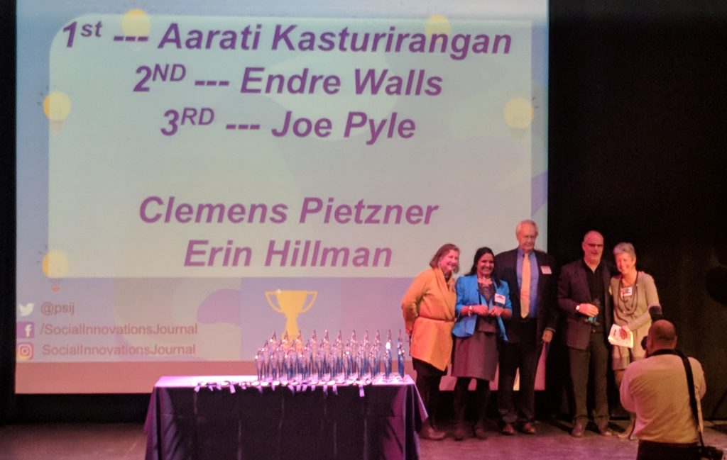 Aarati Kasturirangan poses with other honorees at social innovation awards ceremony