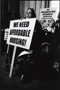 """Photo of PAHC protest focusing on a sign reading """"We need affordable housing!"""""""
