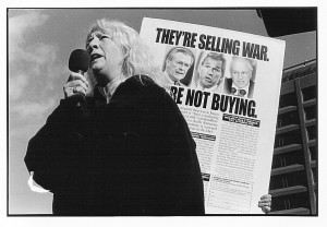 photo of BLSP protest with a person speaking in front of an anti-war sign