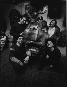 photo of SpiralQ members holding a large puppet head