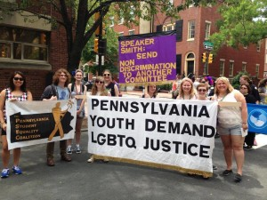 "Group of young people holding a banner that reads ""Pennsylvania Youth Demand LGBTQ Justice"""