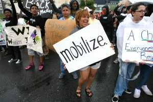 """Members of PPEHRC with signs such as """"mobilize"""" and """"Black Lives Matter"""""""