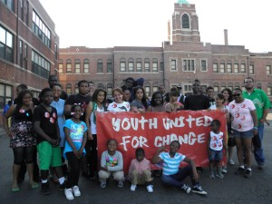 "Photo from Youth United for Change protest with a banner that reads ""Youth United for Change""."