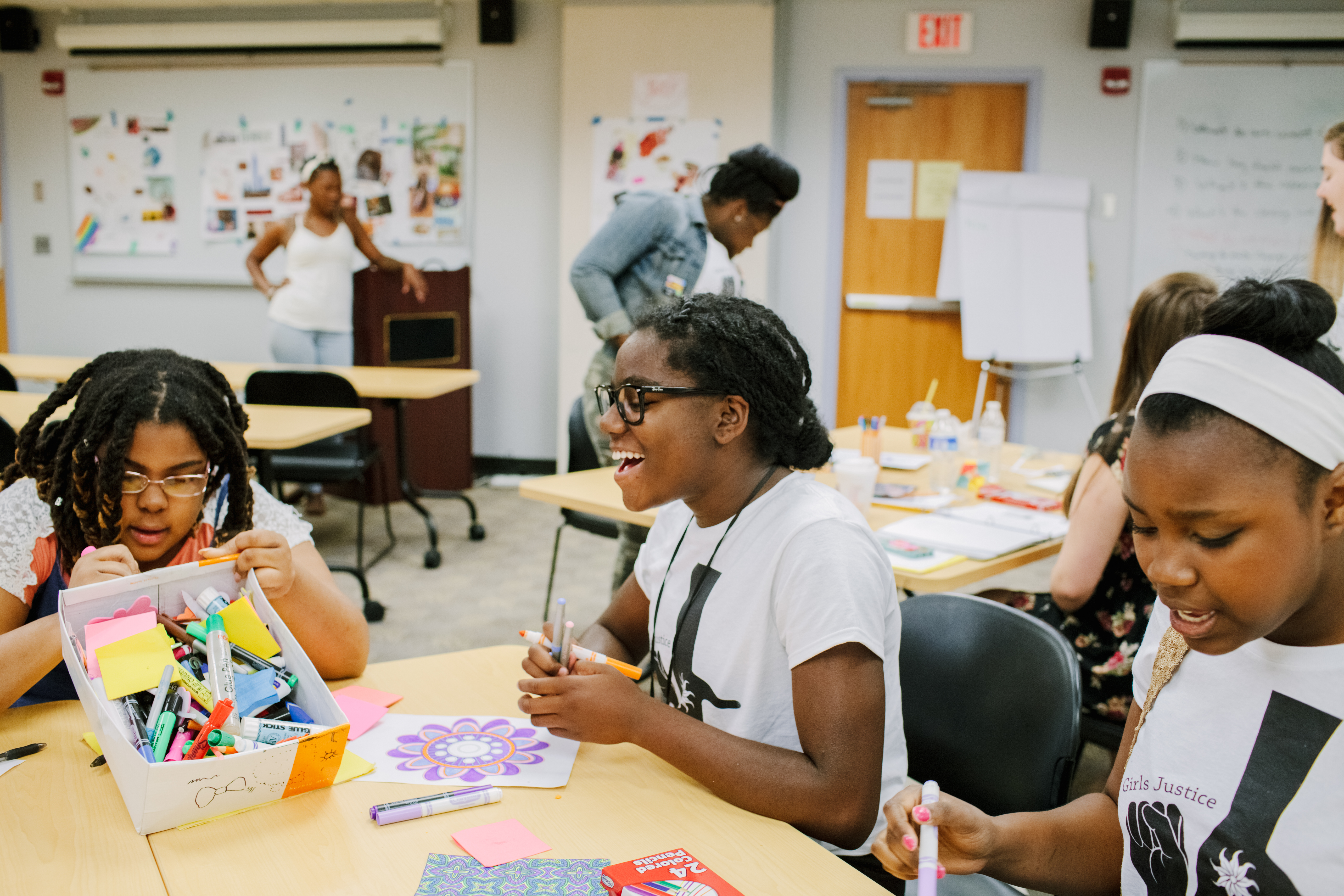 Members of Girls Justice League make art at the Summer Justice Institute in July.