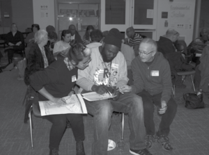 Participants at February's Roots Town Hall work together to identify changing neighborhoods on a map. Photo Credit: Megan Forman.