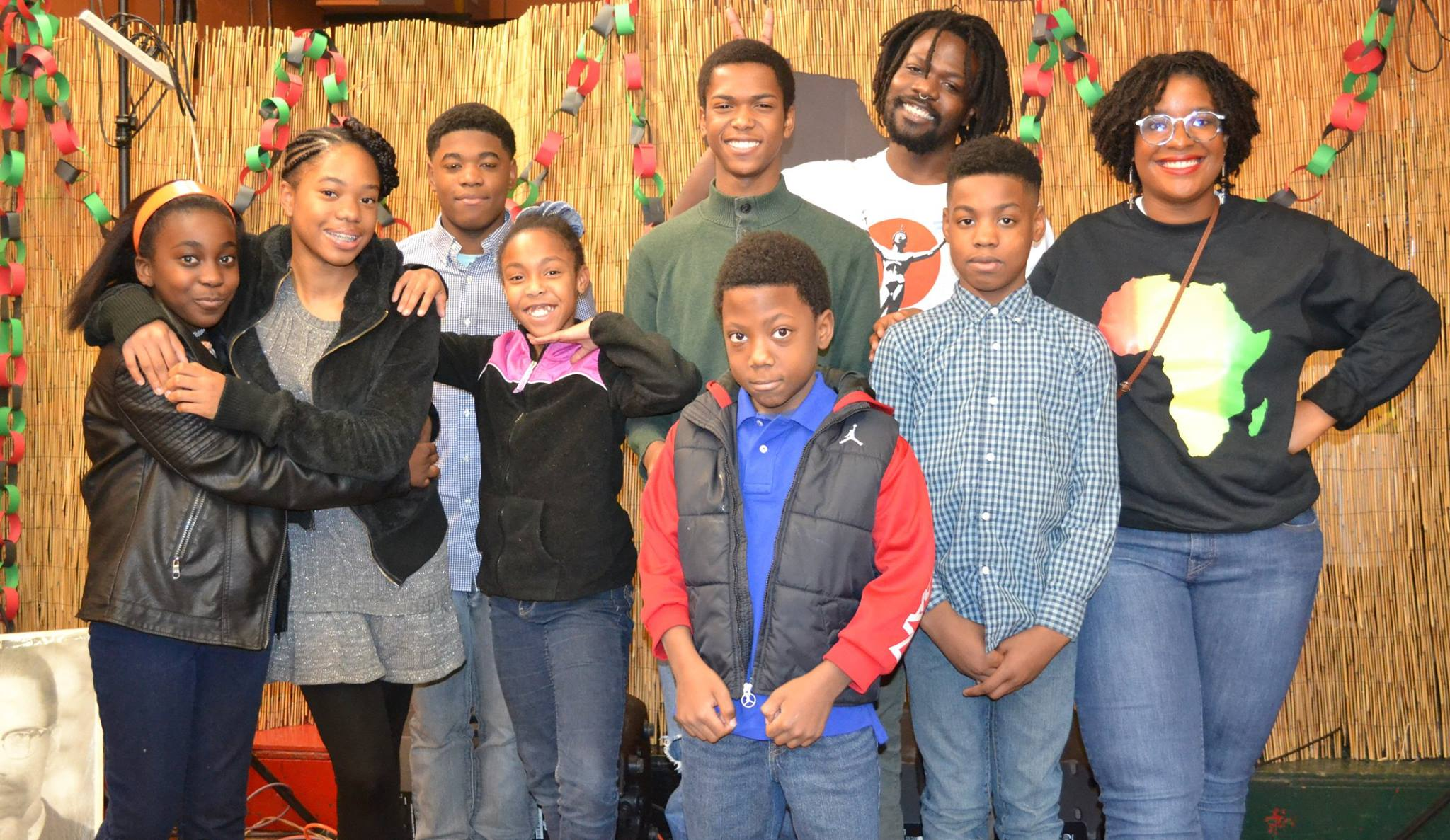 Adults and children celebrating Kwanzaa