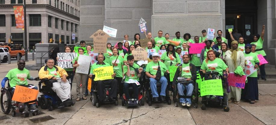 Activists for affordable housing gather outside City Hall
